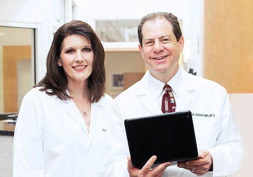 Dr. Joel Schlessinger and Jackie Hall