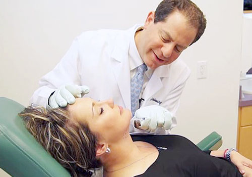 Dr. Joel Schlessinger performing Kybella injections.